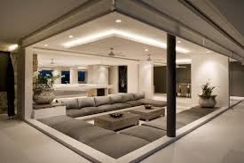 Stylish designs living room White Sofa This Sunken Living Room Looks Extremely Cozy With Its Warm Earthy Tones And Modern Mood Home Stratosphere 64 Stylish Modern Living Room Ideas photos