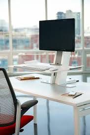 humanscale quickstand fixed to height adjule desk converter