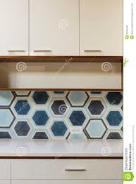 Wood Trim Kitchen Cabinets White Kitchen Cabinet In Modern Home With Blue Tile Royalty Free