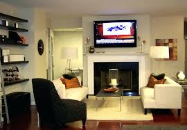 pictures of tv over fireplace hanging a flat screen