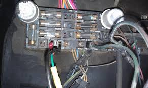 back to my electrical be nightmare ugh the 1947 present that is what my panel looks like right now hei wire is run to the ign on fuse panel the wire next to it runs to nowhere aside from a spliced