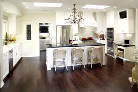 delightful black and white kitchen ideas also dark brown laminate floor and gorgeous chandelier design also comely rattan bar stools classic cabinet and