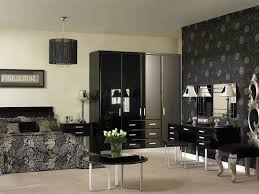 bedroom furniture in black. fitted bedroom furniture shown in high gloss black
