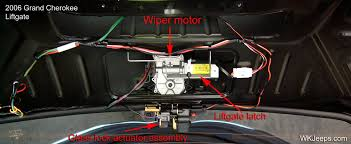 jeep grand cherokee wk interior trim removal inside of liftgate showing wiper motor and lock components