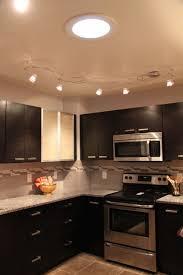 track lighting ideas. Modern Corner Track Lighting Illuminates The Cabinets Ideas S