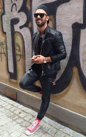 a black quilted leather biker jacket and black leather sweatpants are a perfect combo to be