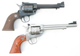 the ruger single nine bottom is a nine shot single action 22 wmr revolver that is modeled after the ruger single six top
