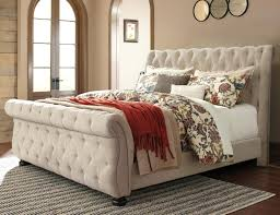 Willenburg Queen Upholstered Sleigh Bed with Tufting by Signature