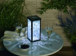 decorative solar lantern with frosted scroll glass for patio lighting ideas