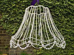 there you have it a great garden centrepiece that cost me next to nothing i can think of lots of uses for my chandelier garden parties weddings