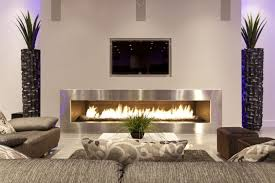 wall mount modern fireplace with seating area and tv set of airy living area