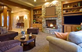 living room with stone fireplace. with built-ins on either side, this stone fireplace is the focal point of living room s