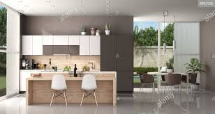 Modern Kitchen Of A Modern Villa With Island And Dining Table With