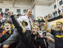 milford pins down div ii state wrestling title usa today high milford players hoist head coach don parsley into the air after winning the diaa division ii