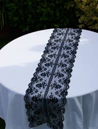 small round wedding dining table with white fabric cover and black lace table runner ideas