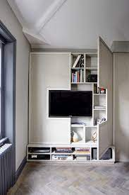 The gloss of the unit goes perfectly with the neutral wall. Elegant Contemporary And Creative Tv Wall Design Ideas