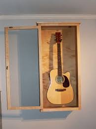 acoustic guitar display case wall mount