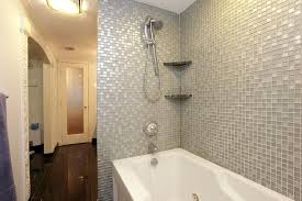 bathroom shower tub tile ideas white wooden sliding glass window white vanity between bathtub white ceramic