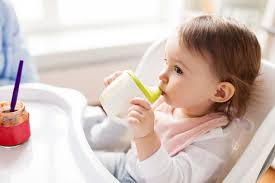 The pros and cons of cups, <b>sippy cups</b>, and straws