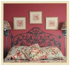 Amazing Black Painted Headboard In A Truly Red Wall Painting With Colorful  Flower Pattern For Bed Cover
