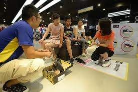 a customer tries on an adidas shoe at the company s in datong shanxi province hu yuanjia china daily