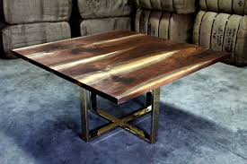 living wood design created this live edge walnut desk with salvaged slabs of ontario walnut for a client who wanted a sleek modern matte brass base