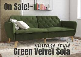 tufted green velvet sofa on