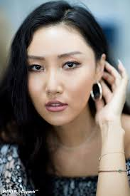 hwasa s makeup plements her rich skin tone rather than washes it out she often chooses lip colours from a brown or purple colour palette rather than the