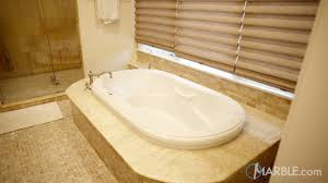the natural stone industry sees a huge demand for natural stone bathtub surrounds as it helps to unify the overall look in a bathroom while drawing together
