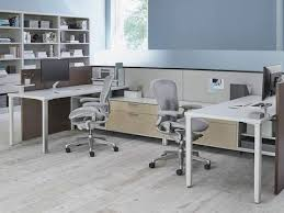 deck screen desk office furniture. Two Light Gray Aeron Ergonomic Office Chairs In A Shared Canvas Office  Landscape Workspace With Bookshelves Deck Screen Desk Furniture