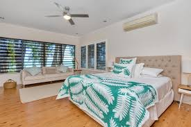 a bed or beds in a room at seascape luxury beachfront house