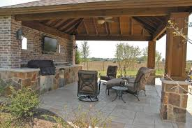 patio cover with stone column bases and stone bbq island in mckinney