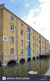 Converted Victorian warehouses at London's Royal Victoria Dock, next to the  new Excel Exhibition Centre
