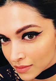 a catty look with winged eyeliner grunge makeup is making a eback try thes