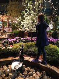 katsenglishblogaddress smile like your happiness depends on it how different parts of this picture has bright colors that pop while the rest is faded out only the flowers water fountain ax and my sister and
