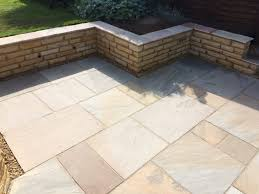 the sandstone retaining wall and sandstone patio area