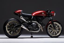 this ducati scrambler cafe racer from poland s eastern spirit garage won the now the bike is you can contact sylwester at eastern