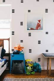 removable black contact paper is responsible for this graphic wall design diy