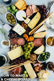 cheese board with olives ers salami and gs