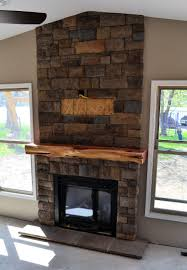 wood fireplace mantel surround with unique reclaimed wood