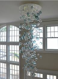 glass bubble chandelier lighting. the bubbles blown glass chandelier is a custom home lighting fixture made by bel vetro bubble