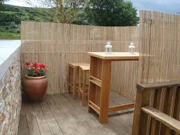 Patio Privacy Fence Outdoor Beautify Your Backyard Deck With Split Bamboo Fencing For
