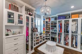 Walk in closet Ikea Antique White Walkin With Painted Fronts And Ottoman Elle Decor Custom Closets Closet Organization Design Closet Factory