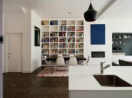 cheshire bookshelves next to fireplace with glass shade dining room contemporary and black pendant lights floor
