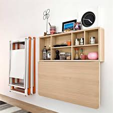 wood wall mounted furniture storage with drop down door beside mounted folding chair storage for saving small spaces ideas
