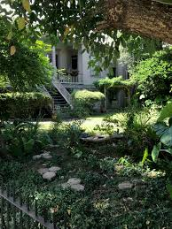 a shady garden in new orleans front porch included photograph by the gut via
