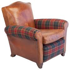 small scale club chair in leather and tartan plaid for