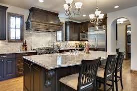 vintage kitchen interior design with double mini chandelier over white granite countertop kitchen island