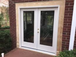 upon delivery of the new door we took out the old door to be hauled away and eased the new one in place we then constructed new framework and trim for