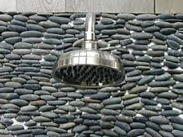 add shower hardware to sponge cleaned river rock